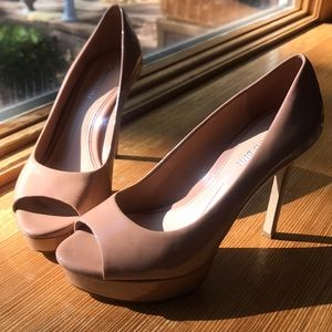Cream colored high heeled shoes
